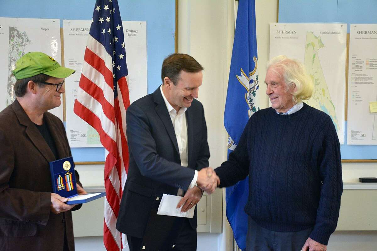At a ceremony at the Sherman Town Hall on Thursday, U.S. Senator Chris Murphy, D-Conn., presented a congressional certificate and the Korean Ambassador for Peace Medal to Thomas Alexander White.