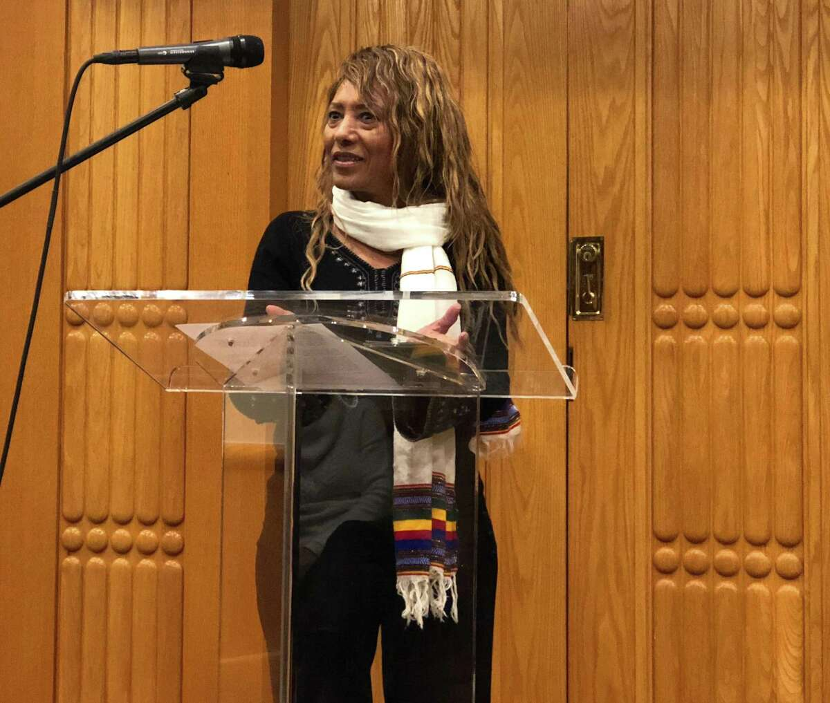 Bizu Riki Mullu, an Ethiopian Jewish activist, speaks to a crowd at Temple Sholom in Greenwich about her family?'s quest to migrate to Jerusalem.