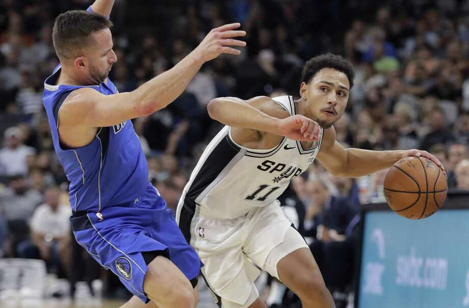 San Antonio Spurs guard Bryn Forbes (11) drives around Dallas Mavericks guard J.J. Barea (5) during the second half of an NBA basketball game, Monday, Oct. 29, 2018, in San Antonio. San Antonio won 113-108. Photo: Eric Gay /Associated Press / Copyright 2018 The Associated Press. All rights reserved.
