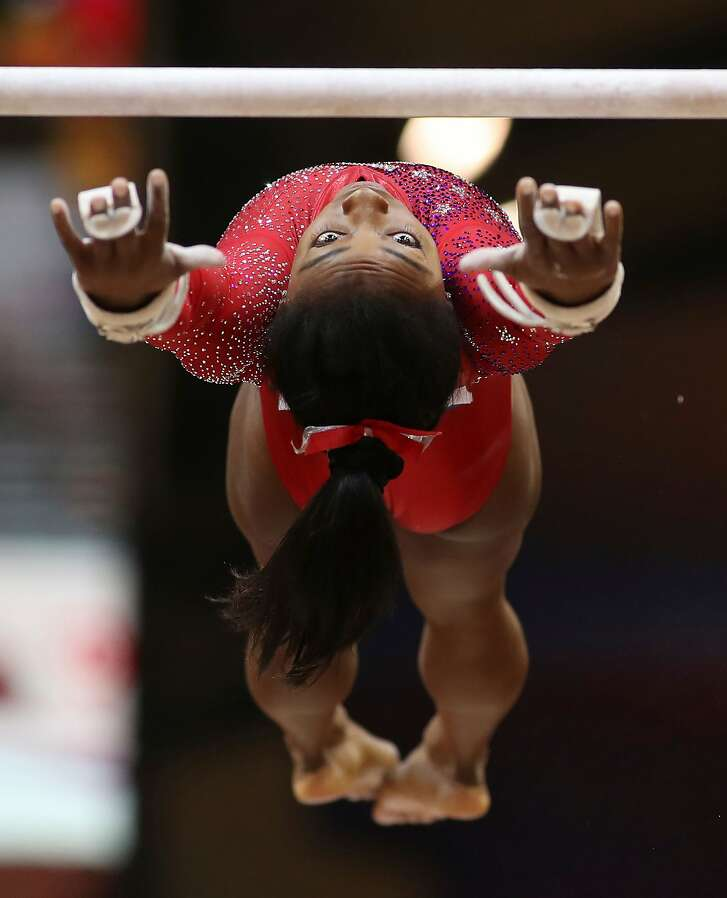 Simone Biles of the US competes in the uneven bars during women's team final of the 2018 FIG Artistic Gymnastics Championships at Aspire Dome on October 30, 2018 in Doha, Qatar. (Photo by KARIM JAAFAR / AFP)KARIM JAAFAR/AFP/Getty Images