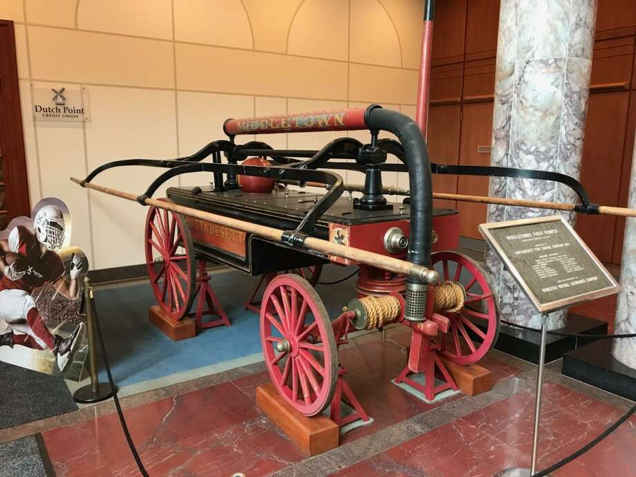 The circa 1803 Middletown fire pumper in the lobby of the Middlesex Mutual Assurance Company on Court Street will be given to the Middletown Fire Department and displayed in City Hall in mid-November. Photo: Contributed Photo