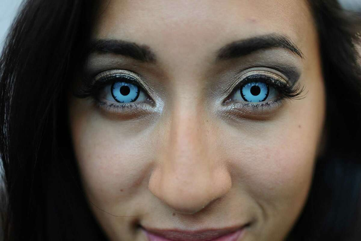 Experts say a Halloween costume with contact lenses can include serious eye infections and even vision loss. Shown here is a 2015 New York Comic-Con attendee.