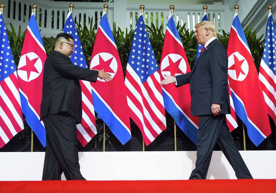 President Donald Trump and Kim Jong Un of North Korea greet each other before their meeting on Sentosa Island in Singapore, June 12. Of late, negotiations between the two nations have not been going well, which might change with Trump's decision to withdraw from the INF Treaty with Russia. Photo: DOUG MILLS /NYT / NYTNS