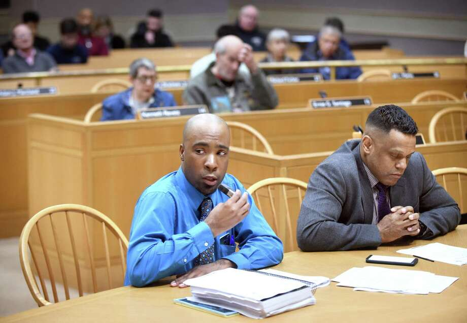 New Haven Acting Budget Director Michael Gormany (center) speaks before the New Haven Board of Alderman Finance Committee at City Hall in New Haven in 2018. At right is Controller Daryl Jones. Photo: Arnold Gold / Hearst Connecticut Media File Photo / New Haven Register