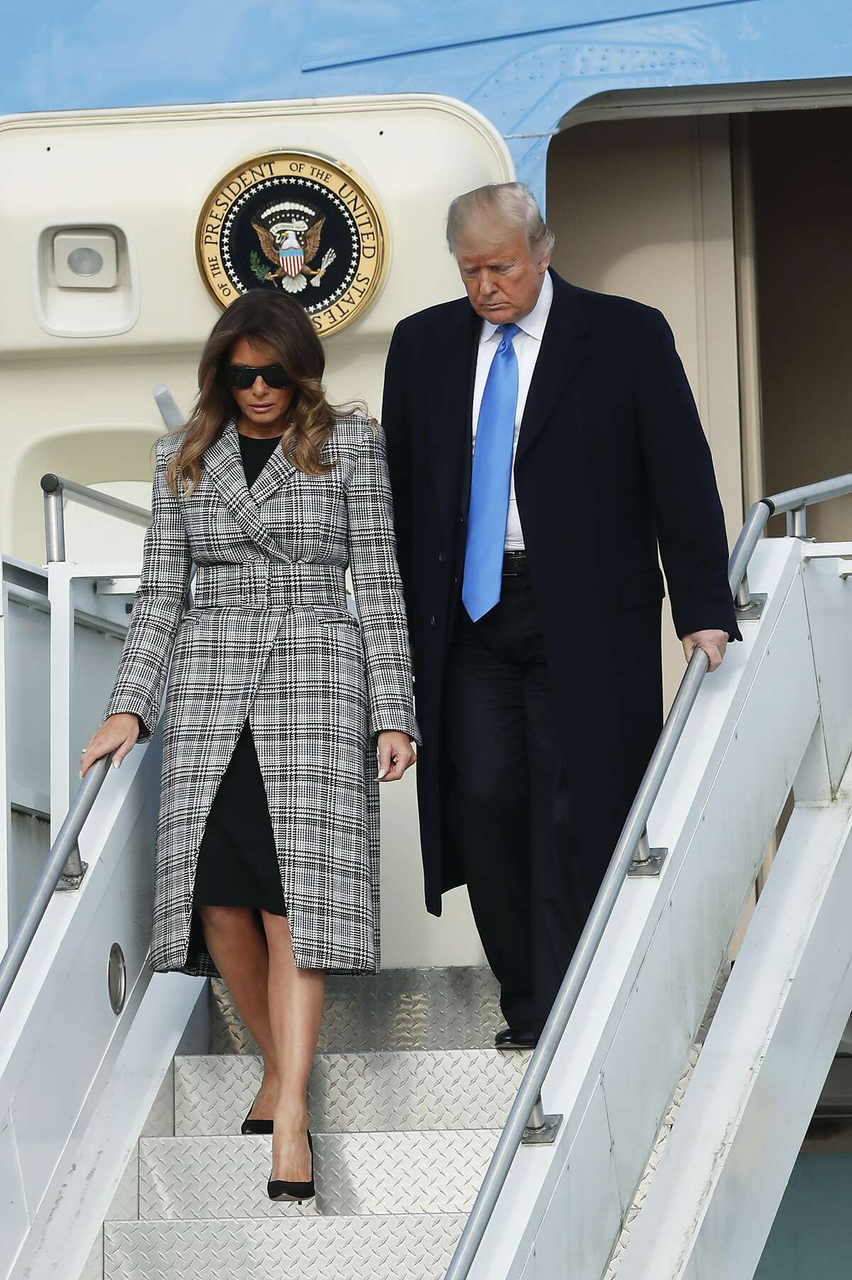 President Donald Trump, right, departs Air Force One as he arrives with first lady Melania Trump on Tuesday, Oct. 30, 2018 in Coraopolis, Pa. The Trumps came to Pittsburgh honor the victims of the deadly shooting at a synagogue in Pittsburgh's Squirrel Hill neighborhood on Saturday. (AP Photo/Keith Srakocic)