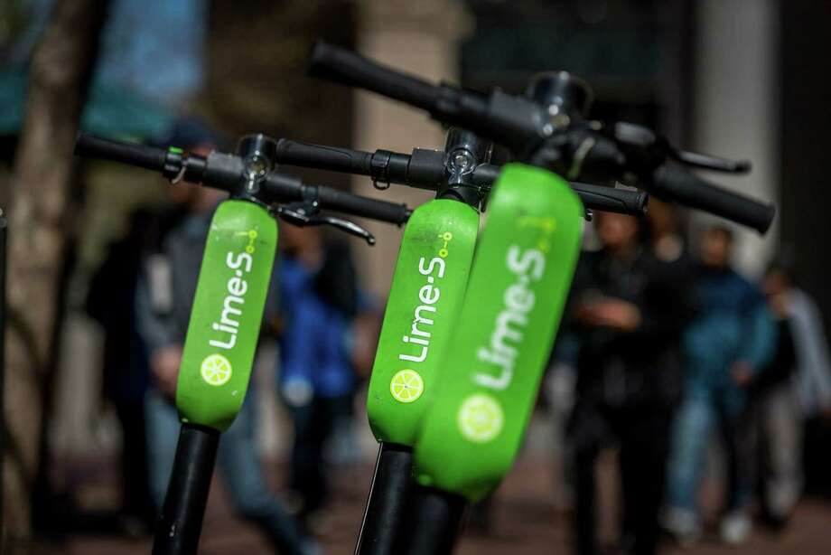 Neutron Holdings LimeBike shared electric scooters sit parked on Market Street in San Francisco on April 13. Photo: Bloomberg Photo By David Paul Morris / Bloomberg