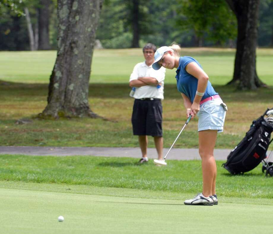 Juliana Staab putts on the 18th green during the Town of Greenwich Women's Tournament at the Griffith E. Harris Golf Course, Greenwich, July 15, 2010.  Staab was the winner of the tournament. Photo: Bob Luckey / Greenwich Time