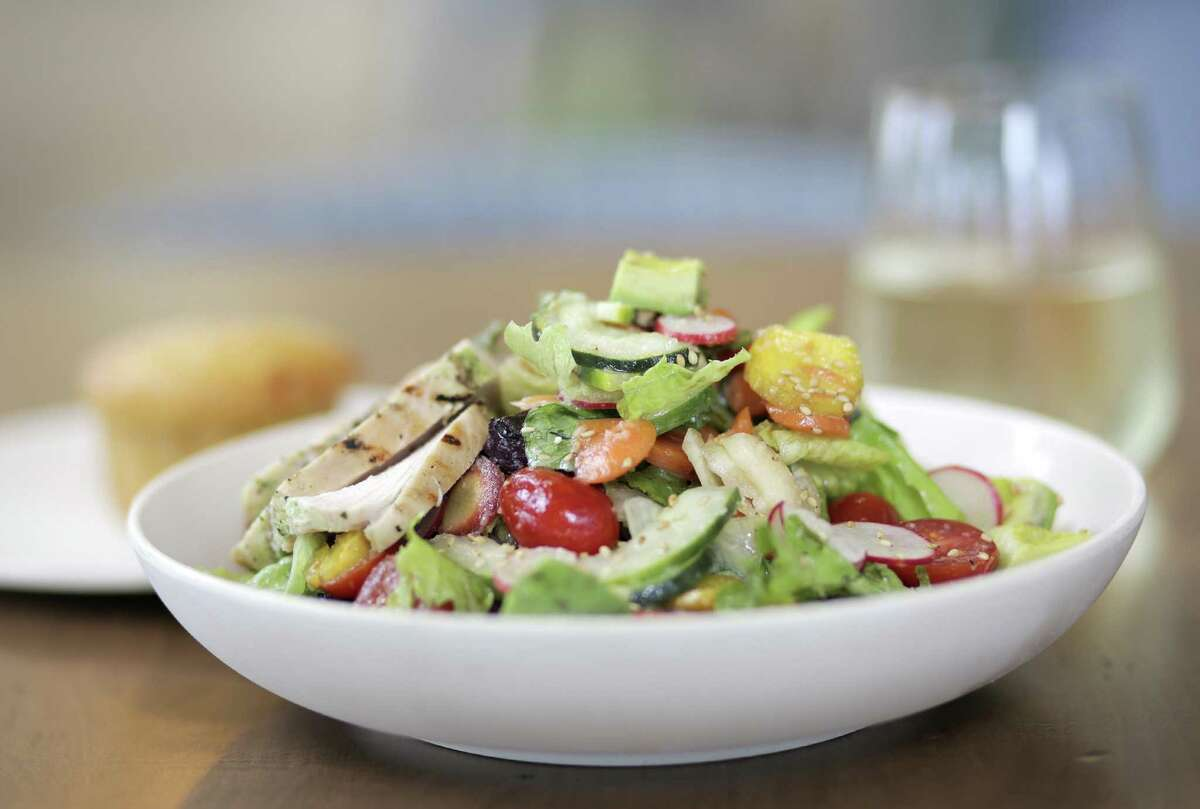 Choppd vegetable salad with chicken served at Flower Child, opening a third location in Houston at 1533 N. Shepherd.