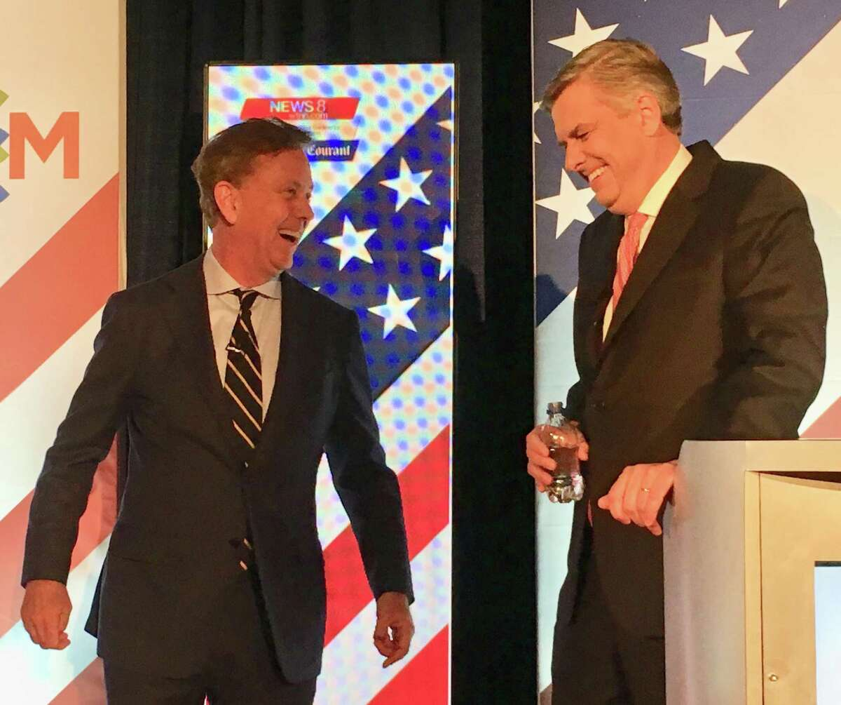 Democratic candidate Ned Lamont, left, shares a laugh with Republican candidate Bob Stefanowski shortly before the two face off during the last gubernatorial debate before the Nov. 6 election at Foxwoods Resort Casino.