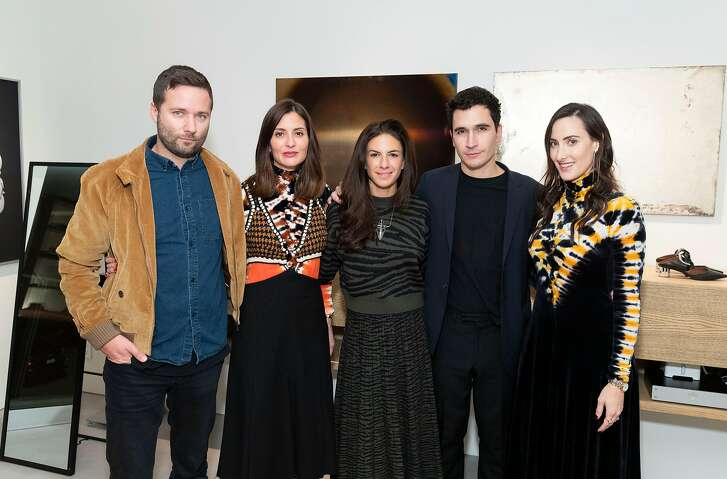 Left to right: Designer Jack McCollough, stylist Mary Gonsalves Kinney, art gallererist Sabrina Buell, designer Lazaro Hernandez and art collector Kaitlyn Krieger at a private trunk show Oct. 19 for Proenza Schouler. SAN FRANCISCO, CA - October 26 - Jack McCollough, Mary Gonsalves Kinney, Sabrina Buell, Lazaro Hernandez and Kaitlyn Krieger attend Proenza Schouler Cocktail 2018 on October 26th 2018 at Private Residence in San Francisco, CA (Photo - Drew Altizer Photography)