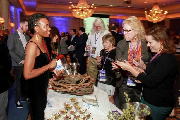 Cymone Caldwell, left, at the Iron Sommelier event at the Houstonian. (For the Chronicle/Gary Fountain, November 9, 2017)