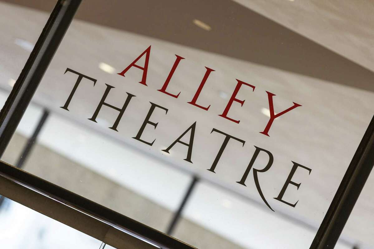 Hundreds of patrons, politicians and well-wishers attend the ribbon cutting opening the Alley Theatre, 615 Texas. They host a free public open house this morning so visitors can get a sneak peek of the Alley's $46.5 million renovation. ID: sign on lobby glass Saturday September 26, 2015 (Craig H. Hartley/For the Chronicle)