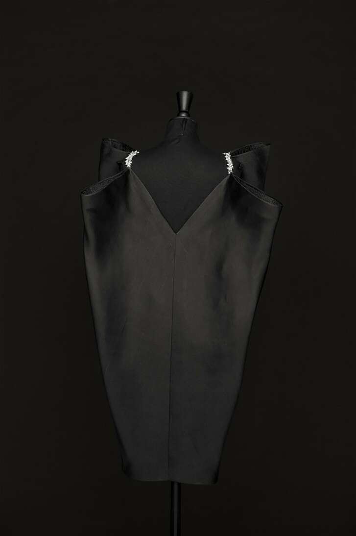 A Cristóbal Balenciaga bias-cut gazar dress from 1967. The straps are embroidered with pronged rhinestones and pearlescent beads, and the dress is trimmed and hemmed with crin mesh ribbon.