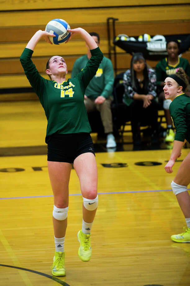Dow High's Charis Queary prepares to set the ball to a teammate during Tuesday's district semifinal match vs. Midland High at Bay City Western. Photo: Katy Kildee/kkildee@mdn.net