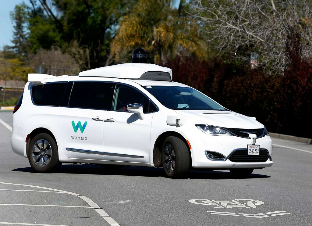 A Waymo self-driving car drives on a residential street in Mountain View, Calif. on Wednesday, March 28, 2018. Photo: Paul Chinn / The Chronicle