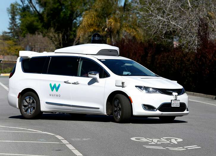 A Waymo self-driving car drives on a residential street in Mountain View, Calif. on Wednesday, March 28, 2018.