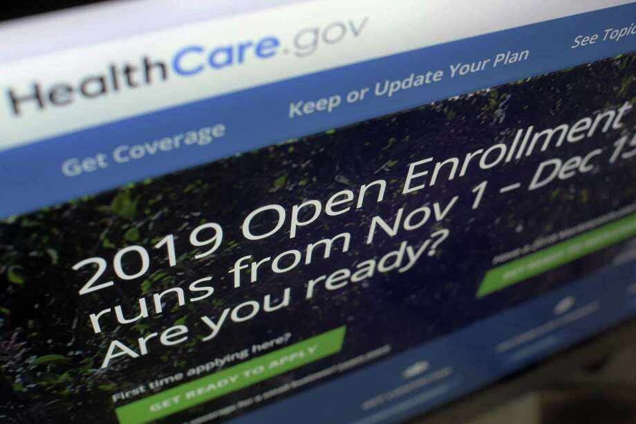This Tuesday, Oct. 23, 2018 photo shows HealthCare.gov website on a computer screen in New York. The sign-up period for next year's individual health insurance coverage runs from Nov. 1 to Dec. 15. Early indicators going into final week showed that the number of people enrolling will be down again.  (AP Photo/Patrick Sison) Photo: Patrick Sison, STF / Associated Press / AP