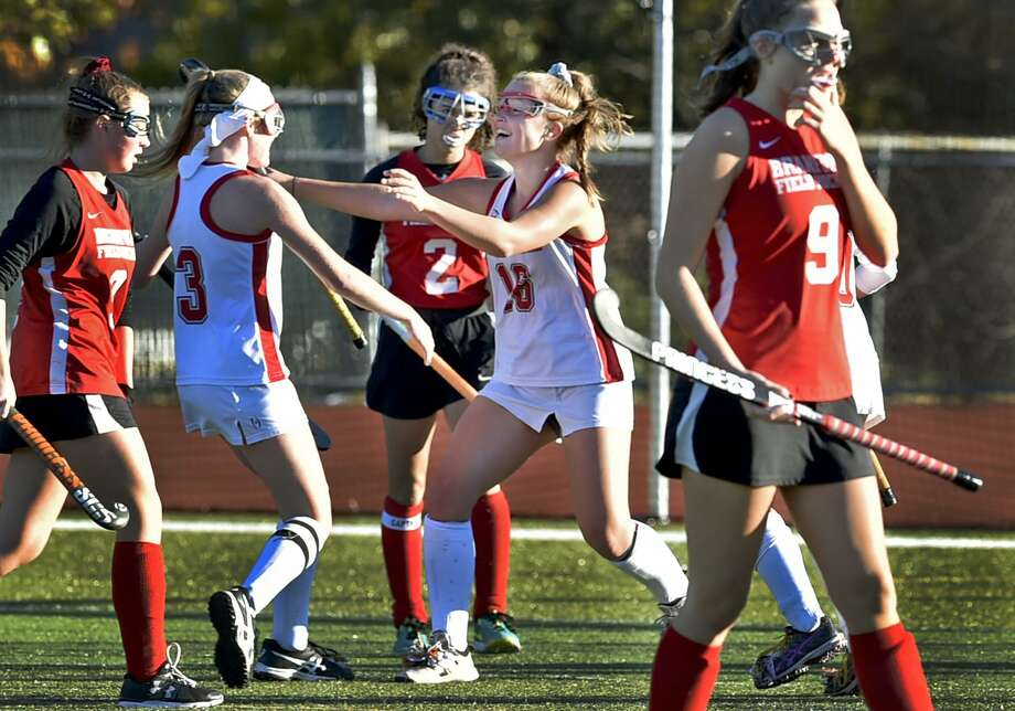 Cheshire' Mikayla Crowly, second from left, and teammate Keagan Bailey celebrate a goal against Branford during the SCC tournament semifinals on Tuesday. Photo: Peter Hvizdak / Hearst Connecticut Media / New Haven Register