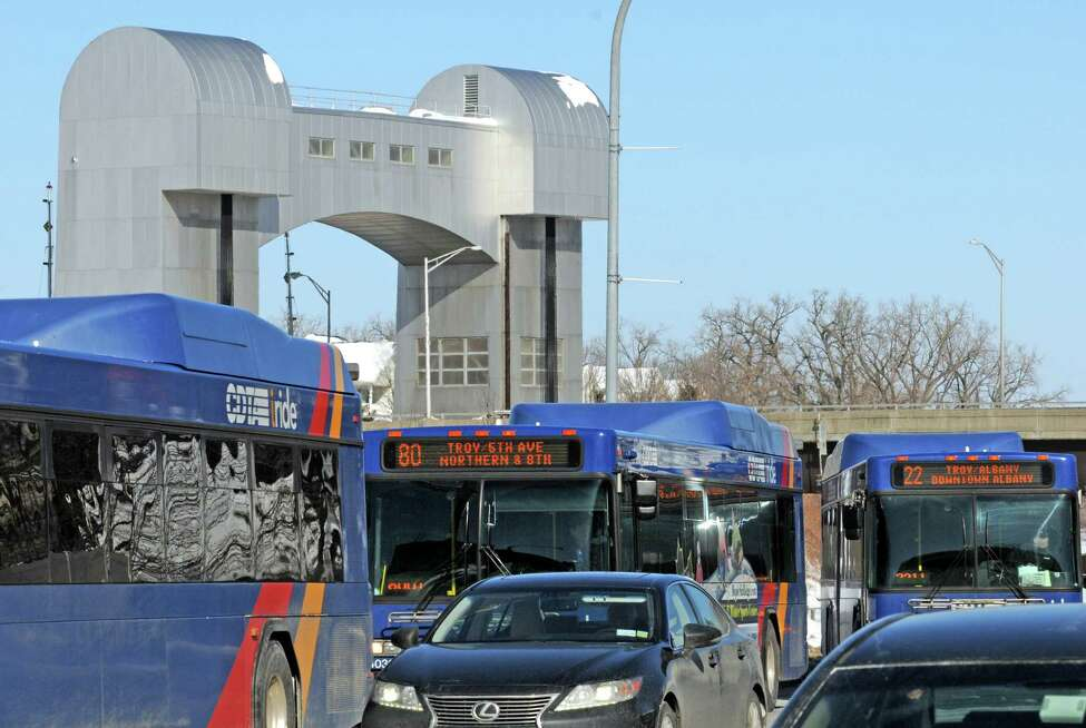 Buses line up along River Street at a bus stop on Friday Feb. 13, 2015 in Troy, N.Y. (Michael P. Farrell/Times Union)