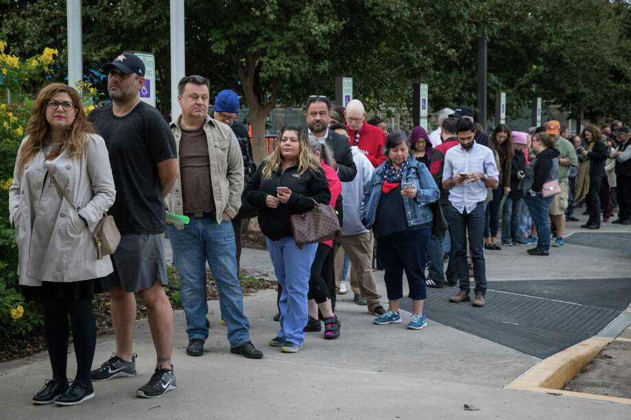 People wait in line to vote at a polling place in Houston on the first day of early voting last week. >> Photos: See the Texas counties with the highest early voting turnout this election... Photo: Loren Elliott, Stringer / Getty Images / 2018 Getty Images