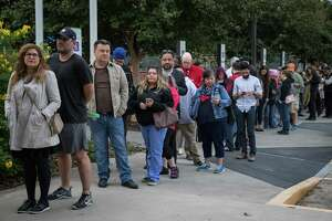 People wait in line to vote at a polling place in Houston on the first day of early voting last week.