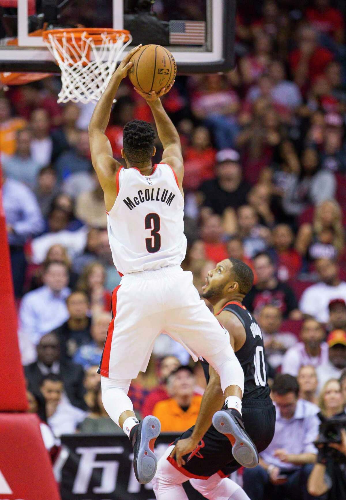 Portland Trail Blazers guard CJ McCollum (3) shoots over Houston Rockets guard Eric Gordon (10) during the first half of an NBA game, Tuesday, Oct. 30, 2018, at Toyota Center in Houston.