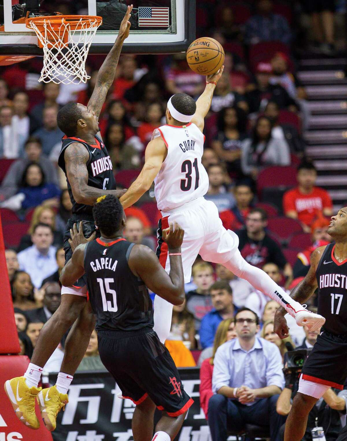 Portland Trail Blazers guard Seth Curry (31) tries to shoot over Houston Rockets forward Gary Clark (6) during the first half of an NBA game, Tuesday, Oct. 30, 2018, at Toyota Center in Houston.
