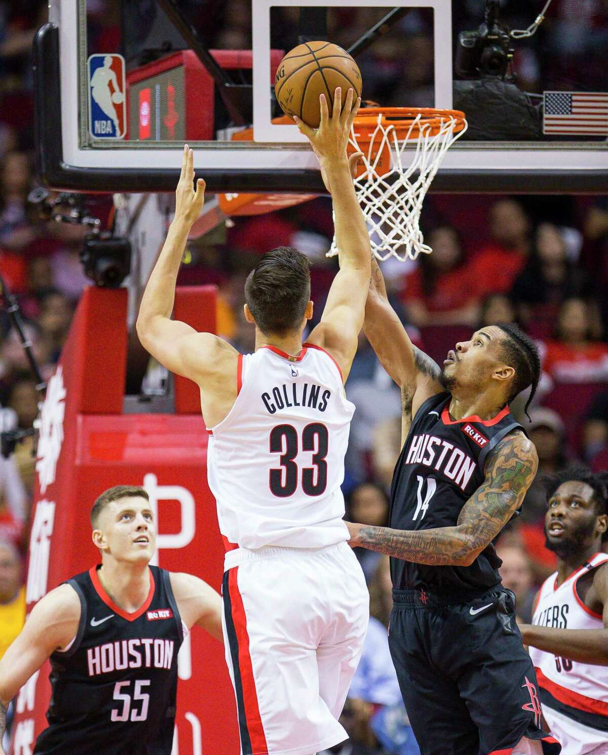 Portland Trail Blazers forward Zach Collins (33) shoots over Houston Rockets guard Gerald Green (14) during the first half of an NBA game, Tuesday, Oct. 30, 2018, at Toyota Center in Houston.