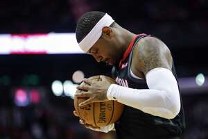 Houston Rockets forward Carmelo Anthony (7) clutches the ball before the start of an NBA game, Tuesday, Oct. 30, 2018, at Toyota Center in Houston.