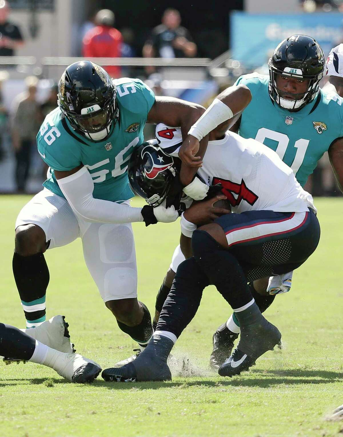 Jacksonville Jaguars defensive end Dante Fowler, left, and defensive end Yannick Ngakoue, right, sack Houston Texans quarterback Deshaun Watson, center, during the first half of an NFL football game, Sunday, Oct. 21, 2018, in Jacksonville, Fla. (AP Photo/John Raoux)