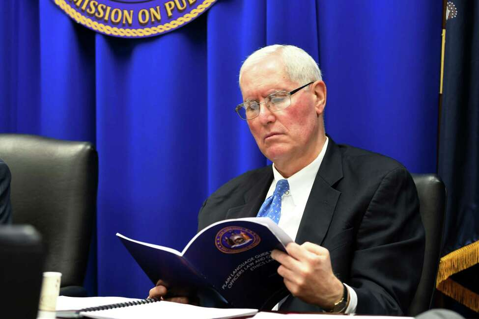 Gary Lavine, a commissioner on the Joint Commission of Public Ethics, reads the agenda during a JCOPE meeting on Tuesday, Oct. 30, 2018, in Albany, N.Y. (Will Waldron/Times Union)
