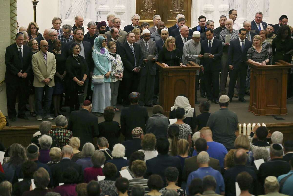Religious and civic leaders gather on stage to sing, This Land is Your Land, as Temple Beth-El hosts a memorial in the wake of last weekend's shooting deaths in a Pittsburgh synagogue on Tuesday, Oct. 30, 2018. As the first funerals took place for the 11 Jewish congregants who were gunned down by a deranged anti-semite at the Tree of Life synagogue in Pittsburgh, the San Antonio Jewish community gathered at Temple Beth-El and opened their place of worship to the public to mourn the victims. (Kin Man Hui/San Antonio Express-News)