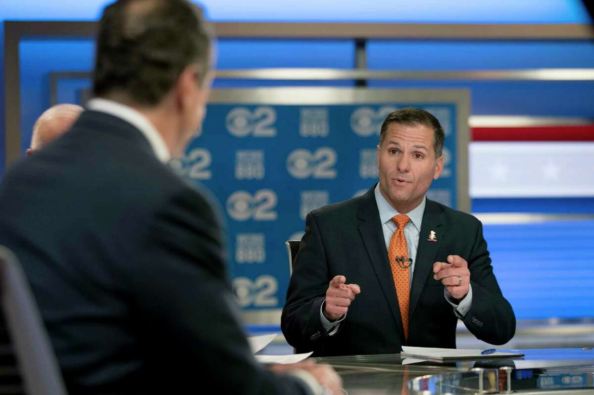 New York Gov. Andrew Cuomo, left, and Republican gubernatorial candidate Marc Molinaro, right, argue during the New York gubernatorial debate hosted by CBS 2 and WCBS Newsradio 880, Tuesday, Oct. 23, 2018, in New York. (AP Photo/Mary Altaffer, Pool)