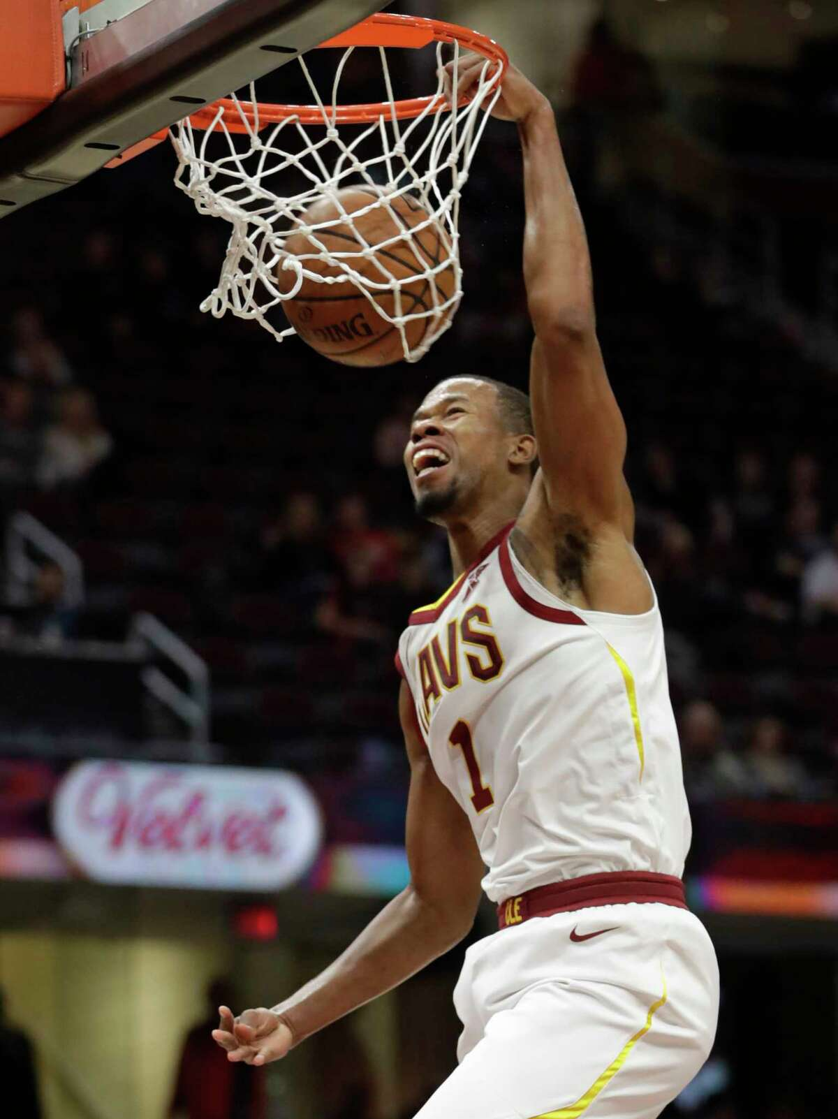 Cleveland Cavaliers' Rodney Hood dunks the ball against the Atlanta Hawks in the first half of an NBA basketball game, Tuesday, Oct. 30, 2018, in Cleveland. (AP Photo/Tony Dejak)