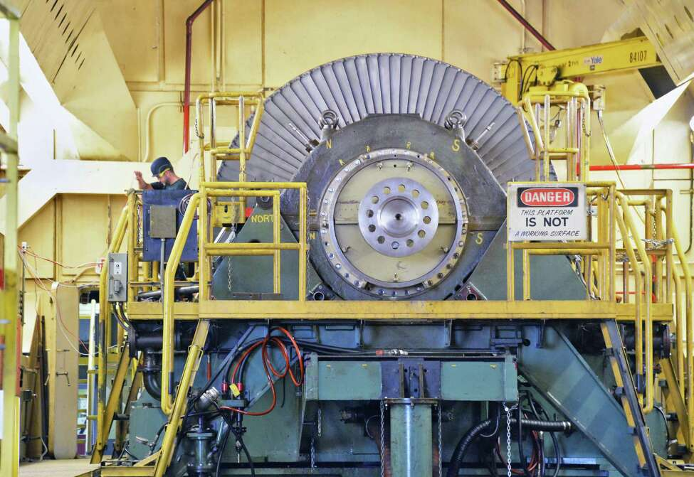 Workers prepare a steam turbine rotor for high speed balancing in the balancing bunkers at GE's main plant test facility Tuesday May 26, 2015 in Schenectady, NY. (John Carl D'Annibale / Times Union)