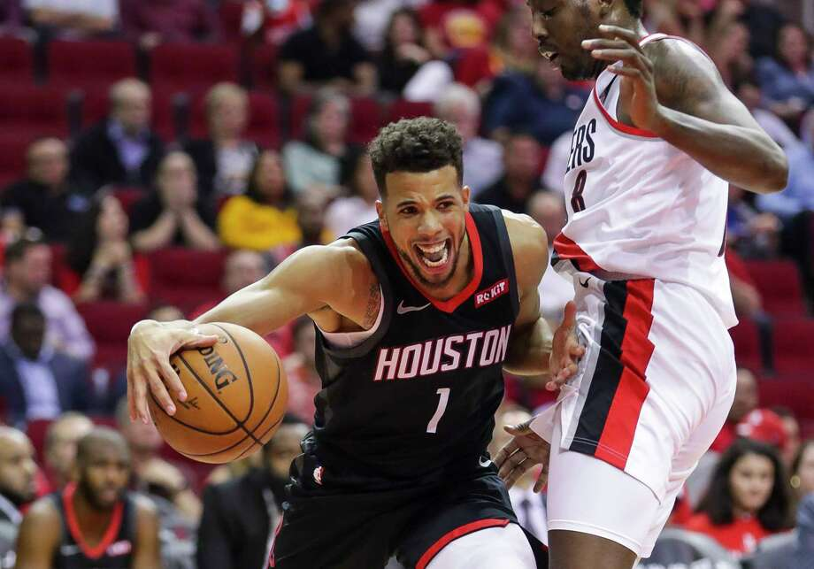 Houston Rockets guard Michael Carter-Williams (1) drives past Portland Trail Blazers forward Al-Farouq Aminu (8) during the second half of the Rockets 104-85 loss to the Portland Trail Blazers, Tuesday, Oct. 30, 2018, at Toyota Center in Houston. Photo: Mark Mulligan, Staff Photographer / © 2018 Mark Mulligan / Houston Chronicle