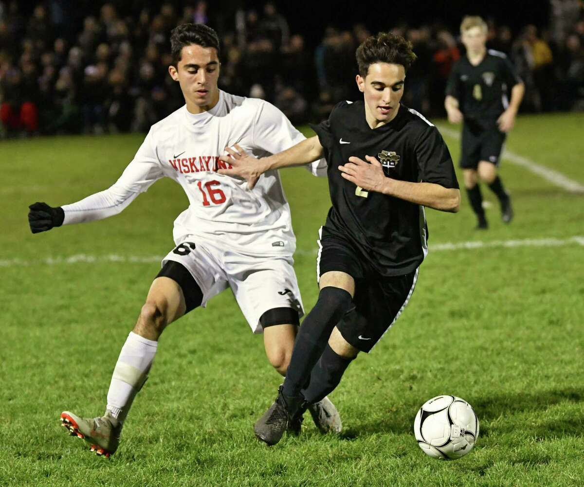 Niskayuna's Keenan Duggal battles for the ball with CBA's Eli D'Onofrio during the Class AA boys' soccer final on Tuesday, Oct. 30, 2018 in Colonie, N.Y. (Lori Van Buren/Times Union)