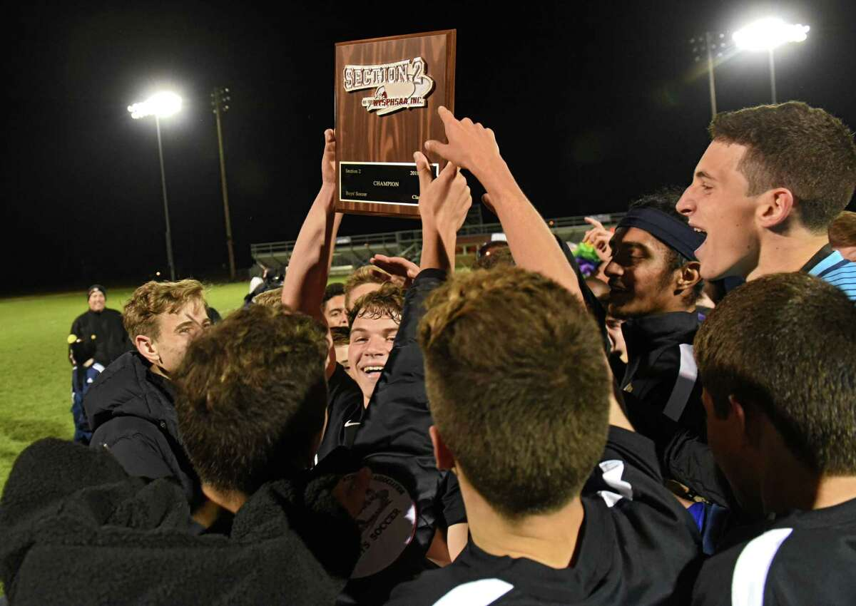 CBA players celebrate after defeating Niskayuna in the Class AA boys' soccer final on Tuesday, Oct. 30, 2018 in Colonie, N.Y. (Lori Van Buren/Times Union)