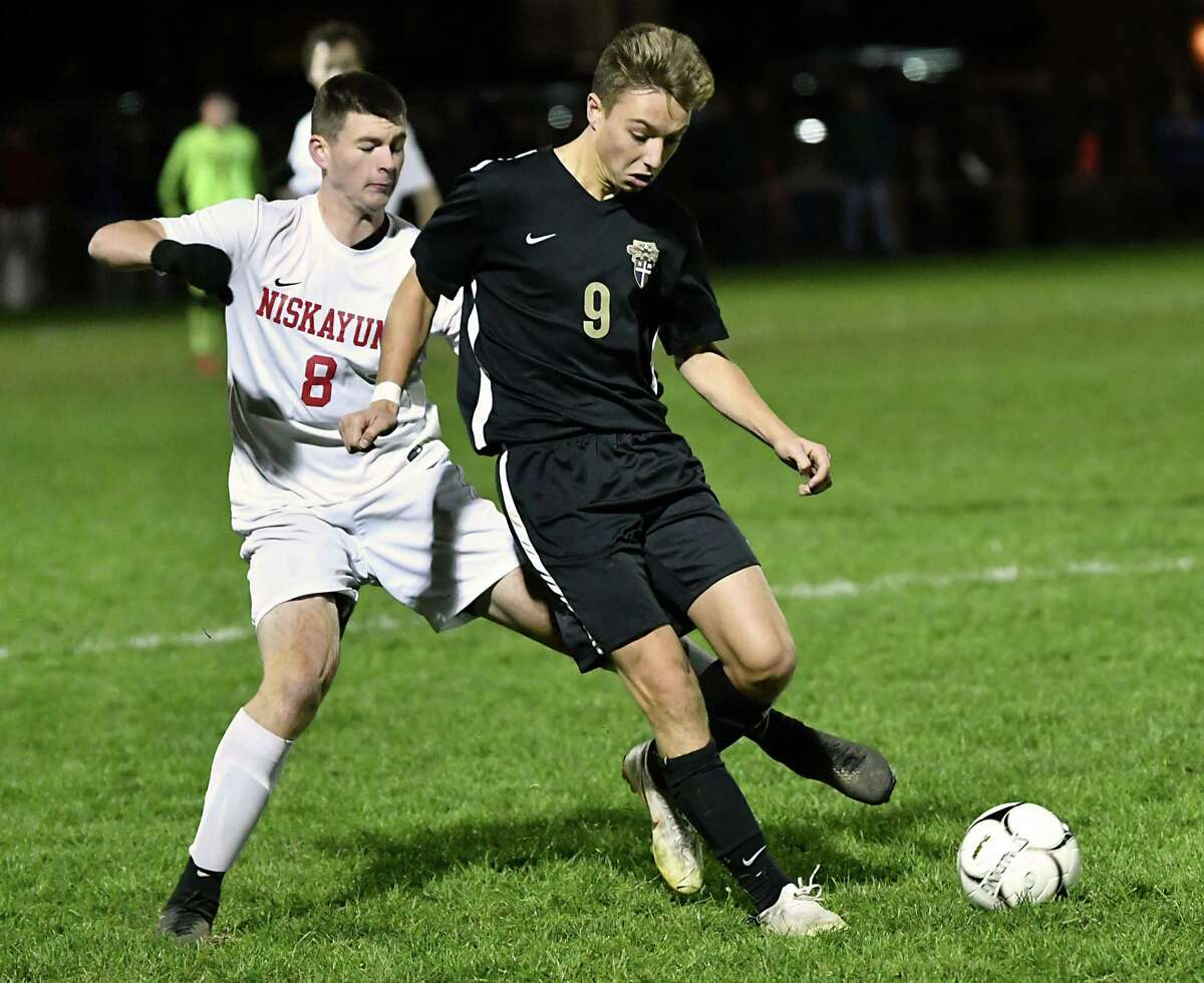 Niskayuna's Jorel Mirabito battles for the ball with CBA's John Mendrysa during the Class AA boys' soccer final on Tuesday, Oct. 30, 2018 in Colonie, N.Y. (Lori Van Buren/Times Union)