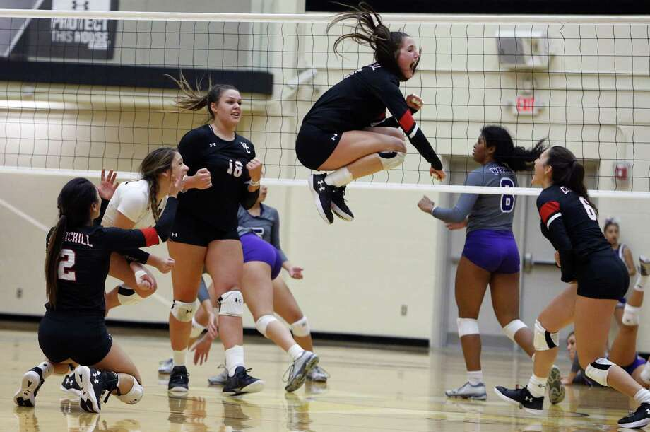 Churchill's Isabel Fichtel ,in air, celebrates with teammates in 4th and final set. VBH class 6A, Churchill v Warren on Tues, October 30, 2018 at Lilleton Gym. Photo: Ronald Cortes/Contributor / 2018 Ronald Cortes