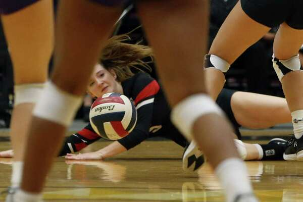Churchill's Emma Sevening dives for the ball. VBH class 6A, Churchill v Warren on Tues, October 30, 2018 at Lilleton Gym.