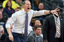 FILE - In this Wednesday, March 7, 2018 file photo, Washington coach Mike Hopkins yells to the team during overtime of an NCAA college basketball game against Oregon State in the first round of the Pac-12 men's tournament in Las Vegas. One look at the preseason rankings provides evidence that next season's NCAA Tournament could feature plenty of new faces. The Top 25 includes four teams that failed to reach last year's NCAA Tournament: No. 14 Oregon, No. 18 Mississippi State, No. 23 LSU and No. 25 Washington.