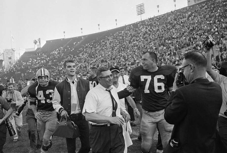 Doug Hart (No. 43) and Bob Skoronski (No. 76) trail their coach, Vince Lombardi, off the field following the Green Bay Packers' 35-10 win over Kansas City in the Super Bowl, Jan. 15, 1967. Photo: Bettmann/Bettmann Archive