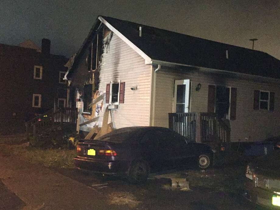 A man was injured early Wednesday when fire tore through a home at 18 Emmett St. in Albany. Photo: Steve Hughes / Times Union
