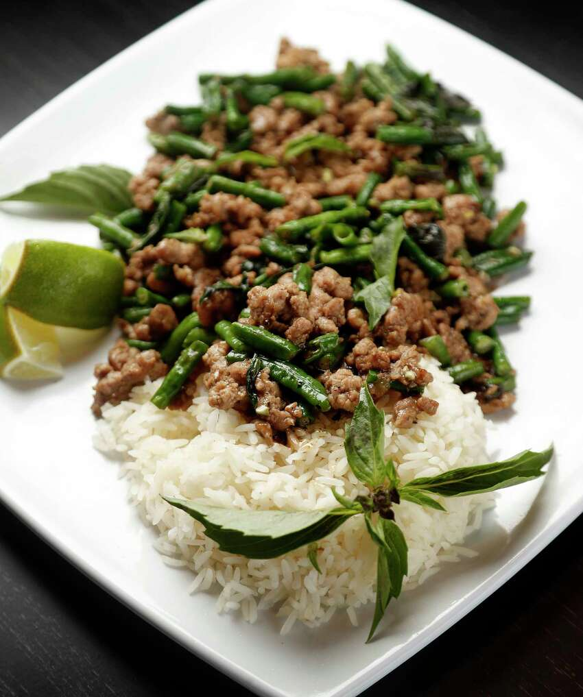 Pad Krapow Moo: Thai basil, pork, green beans and dried chili peppers at Sing, a new Singaporean-inspired restaurant in the Heights.