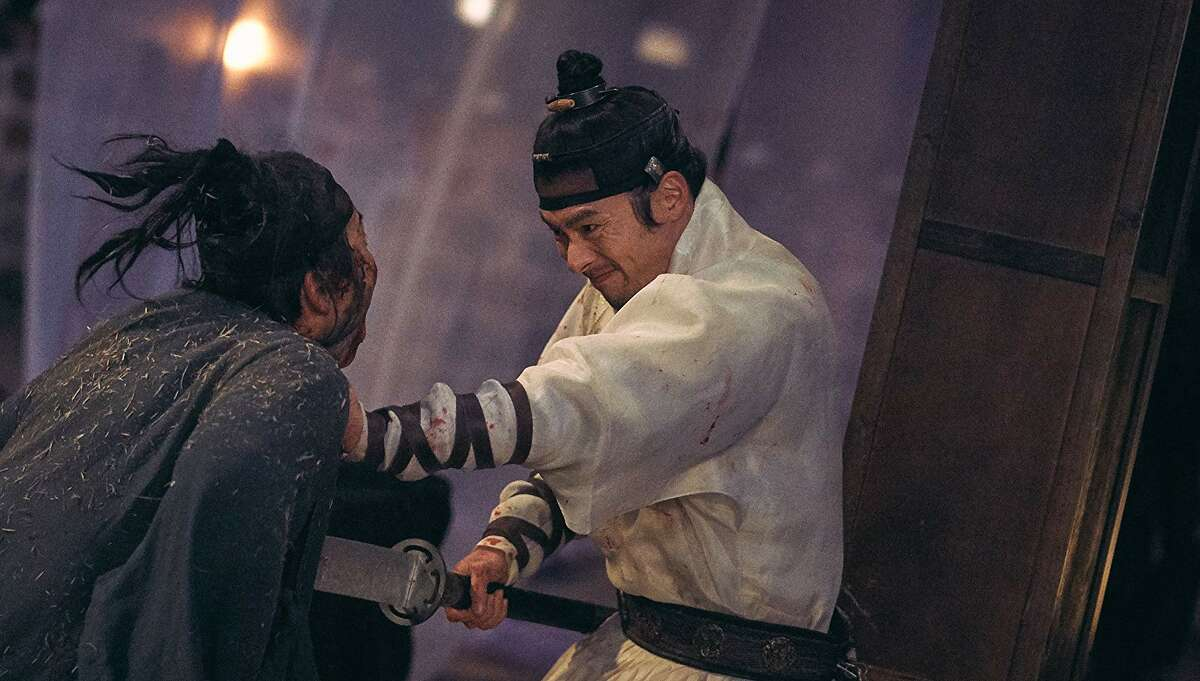 Hyun Bin goes medieval on a zombie in the South Korean film 'Rampant'