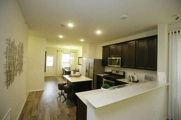 Builders shrink home sizes to appeal to more buyers ... on 1400 square foot open floor plans, 1400 square foot cabin plans, 900 square foot 2 bedroom house plans, 4-bedroom one story ranch house plans,