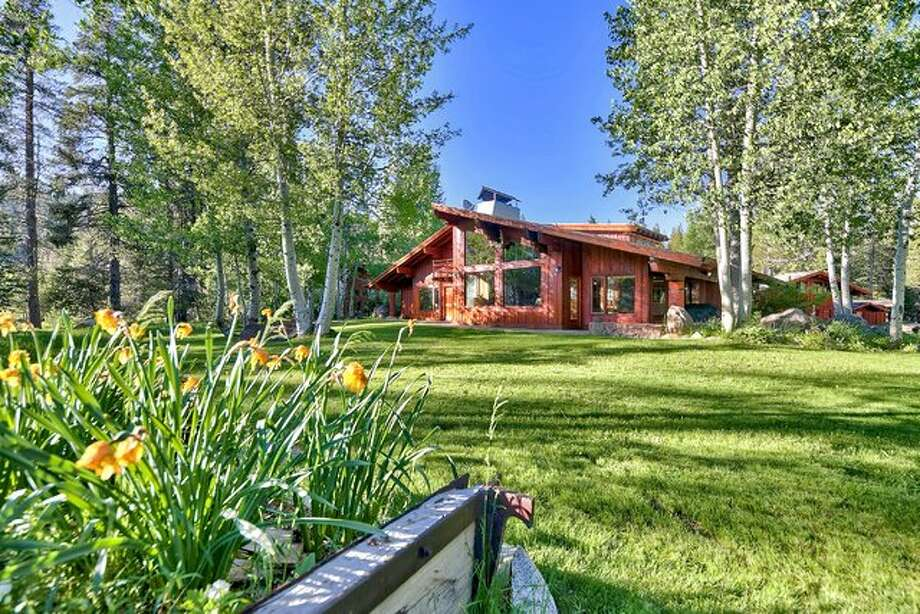 The hand-crafted estate of Squaw Valley Founders, Wayne and Sandy Poulsen sits on nearly 30 acres of aspen and pine groves. It's listed for $15 million with Valerie Forte of Engel & Völkers Truckee. Photo: Engel & Völkers