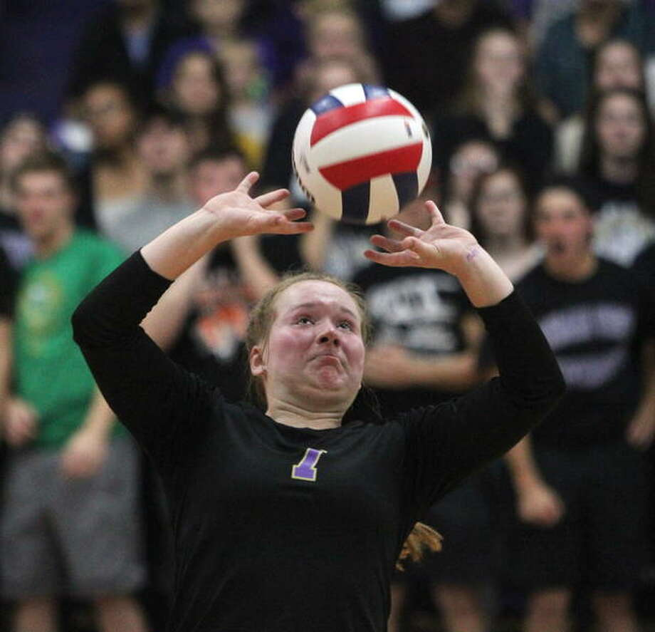 Routt's Makenna Baptist makes a set during Monday night's Routt Sectional semifinal match against Payson Seymour. Photo: Dennis Mathes | Journal-Courier