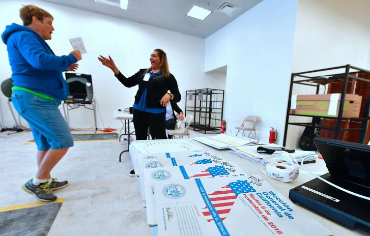 Ballots are dropped off at an Early Vote Center in Huntington Beach, California on October 27, 2018, as voting begins in the traditional Republican stronghold of Orange County. (Photo by Frederic J. BROWN / AFP)FREDERIC J. BROWN/AFP/Getty Images